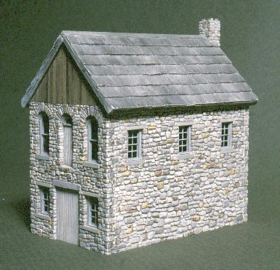 The Stone Shingle Mill features cobble stone walls and a cedar shake roof. It should be built into a hill side.