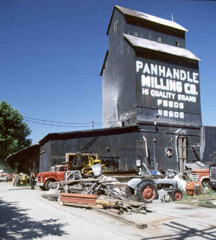 Panhandle Feeds. A grainery with lots of tractors and stuff around.