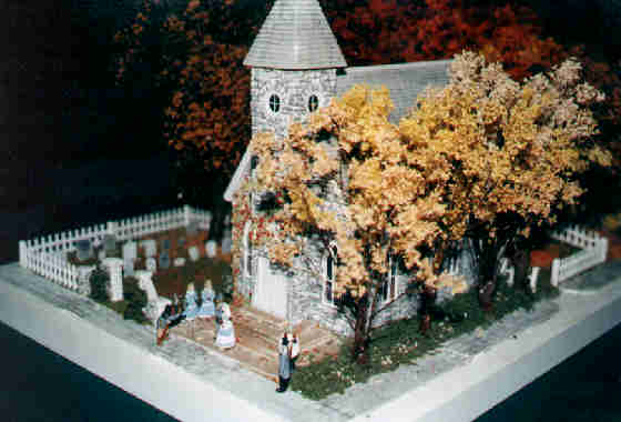 White Stone Church display. A fall wedding is in progress on the steps.
